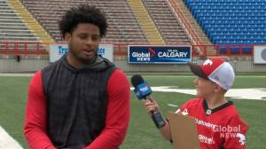Junior reporter Chance interviews Stamps defensive lineman Mike Rose
