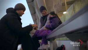 Toronto father and daughter try ice skating for the first time