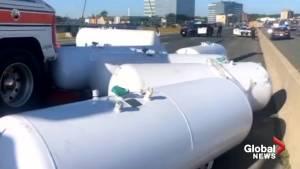 Empty propane tanks fall off trailer onto Hwy 401 E