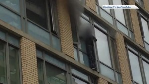 Woman rescued from ledge of burning Toronto apartment charged with arson