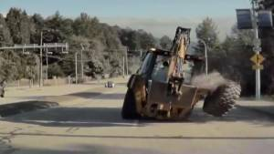 Caught on video: backhoe loses large tire