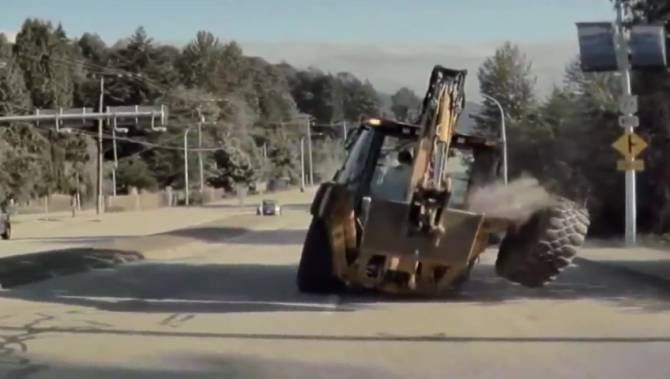 Backhoe loses tire during morning commute, nearly striking pedestrian