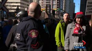 Pro and anti-pipeline protesters clash in Calgary