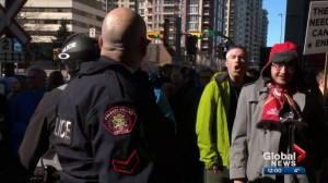 Pro and anti-pipeline protesters clash in Calgary