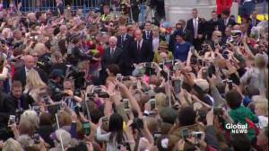Prince William and Kate walk the red carpet to cheers from thousands gathered