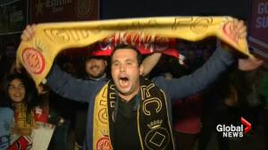 Fans celebrate Catalonia city football team win against Real Madrid