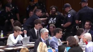Yelling protesters interrupt Kavanaugh confirmation hearing