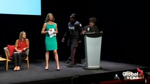 Faith Goldy storms the stage at Toronto mayoral debate, gets escorted off by police