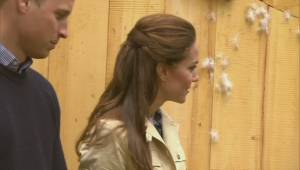 The Duke and Duchess of Cambridge are presented with native paddles