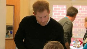 UK's Prince Harry serves up healthy lunches at London youth centre