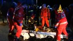 Emergency service workers tend to injured people after stampede at Italian nightclub
