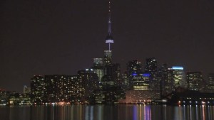 CN Tower lights up Purple for Queen's Birthday