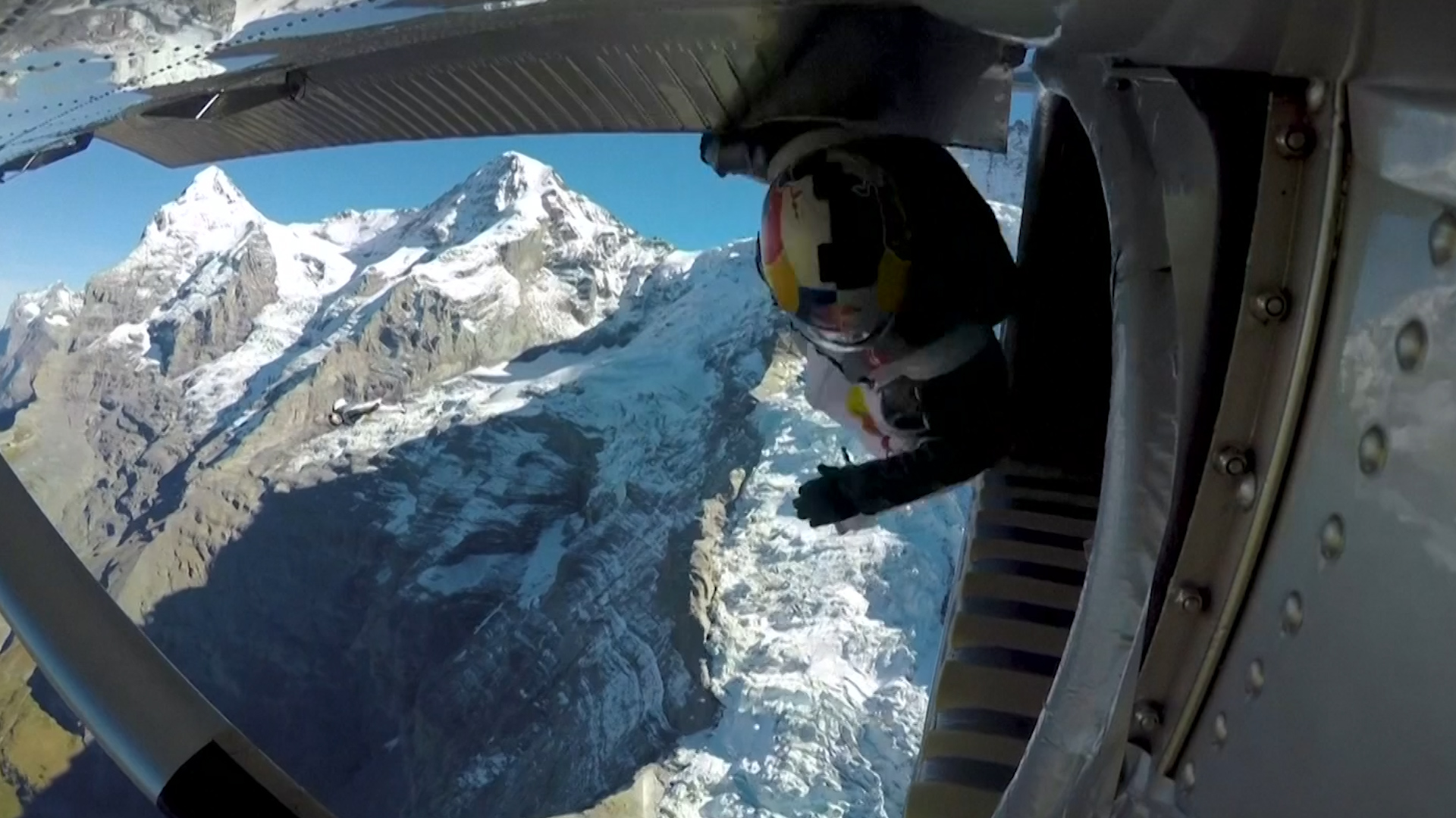 Wingsuit flyers jump from Jungfrau and land inside a plane