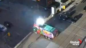 Toronto garbage truck carrying dumpster collides with overhead power line, loses load in intersection