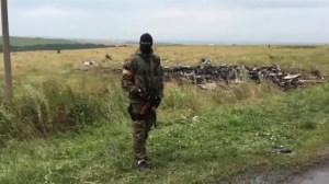Investigators trouble accessing Malaysia plane crash site in Ukraine