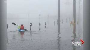 Kayaker paddles through parking lot in Fredericton