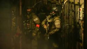 Armed tactical police unit searches building amid G20 protests