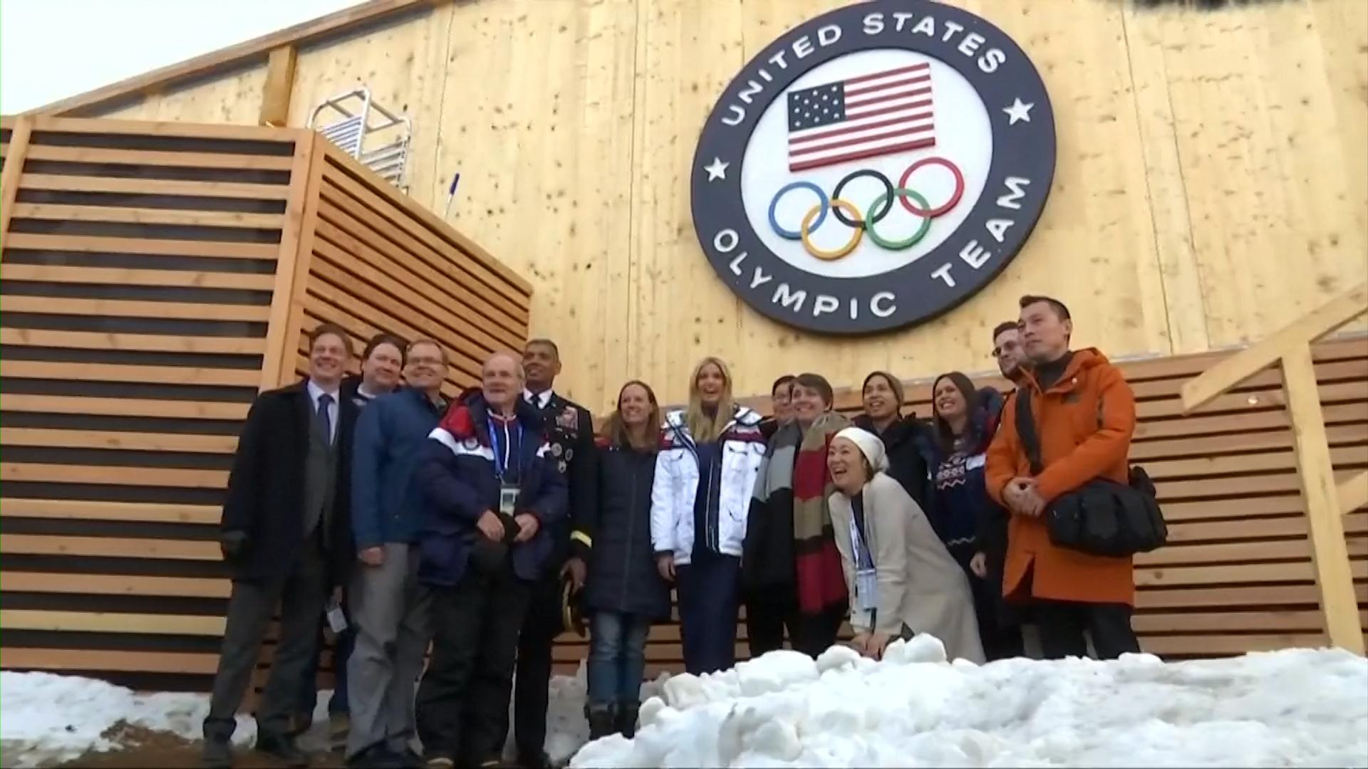 Olympian Lauren Gibbs of Denver lets Ivanka Trump try on silver medal