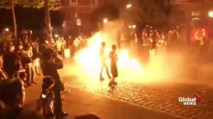 Police put out fires with water cannons as G20 protesters look on
