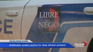 Montreal police to remove stickers: arbitrator