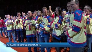 Organizer of World's Longest Hockey Game presented with silver stick at Edmonton Oilers game
