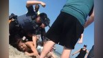 New Jersey police officer punches female beachgoer in head several times during arrest