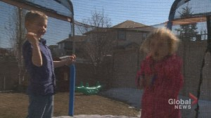 Sound-activated alarm in neighbour's yard has Calgary family dreading upcoming summer