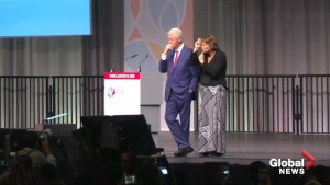 Protesters interrupt former U.S. President Bill Clinton's AIDS conference speech