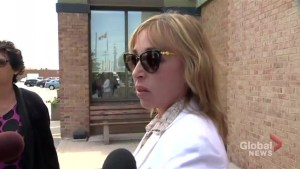 Renata Ford speaks with reporters after receiving court sentence
