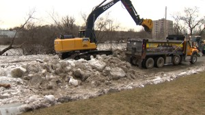 Crews work to cleanup ice jam on Cambridge, Ont. street