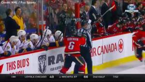 Flames Dennis Wideman sends linesman to ice with hit from behind