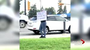 'No regrets,' from Calgary women who held a sign claiming she was being punished for cheating on her boyfriend
