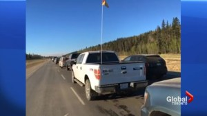 Convoy helping Fort McMurray evacuees escape wildfire zone