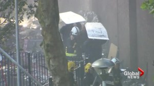 London firefighters evacuate resident of deadly high-rise fire