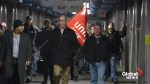 Unionized workers walk off the job after GM reaffirms plans to shut Oshawa facility