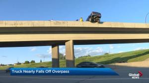 Truck dangles over Deerfoot Trail