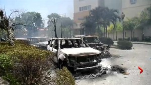 Haiti riots leave behind trail of charred vehicles