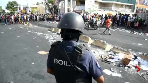 Violent looting in Haiti over gas price hike leaves several dead