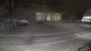Snowstorm time lapse of White House, Lincoln Memorial and Capitol.