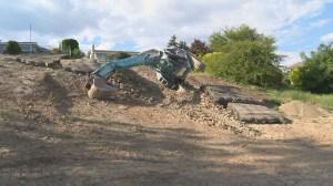 Excavator rolls down slope in West Kelowna