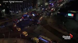 Line of ambulances drive toward London Bridge