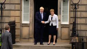 New UK PM Boris Johnson booed on visit to meet Scotland's Sturgeon