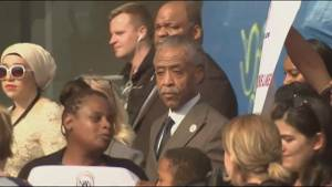 Reverend Al Sharpton marches with protesters before Oscars