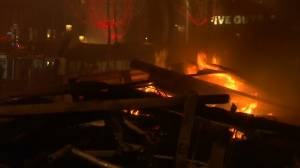 Violent protests continue into the night in Paris over fuel prices