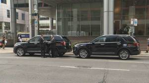 TIFF vehicles parked on busy downtown street