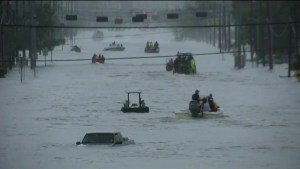 Boats fill roads in Texas as rescue workers provide help during flooding
