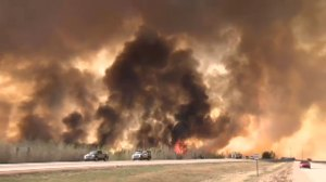 Structures damaged amid Fort McMurray wildfire; crews trying to save downtown core, airport