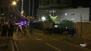 Hong Kong riot police storm through gate after reinforcements arrive