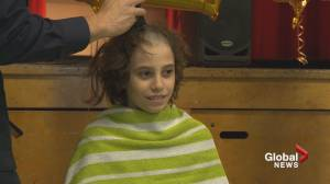 9-year-old shaves head, raises money after dad diagnosed with cancer