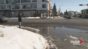 'Swimming hole' of puddles worries Calgary business owners and pedestrians